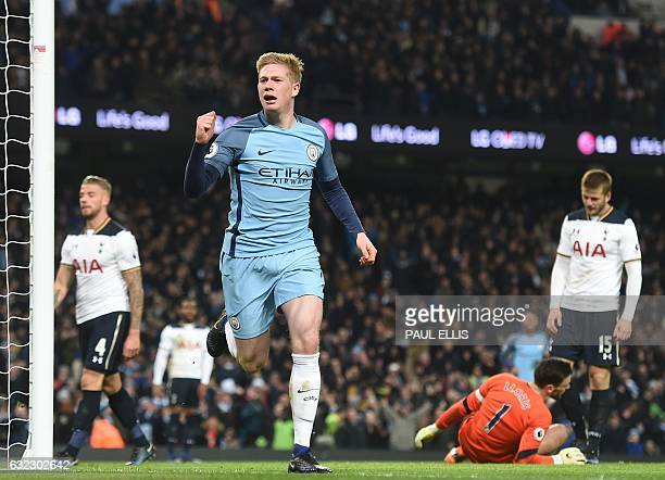 Tottenham Hotspur's French goalkeeper Hugo Lloris reacts as Manchester City's Belgian midfielder Kevin De Bruyne celebrates scoring their second goal...