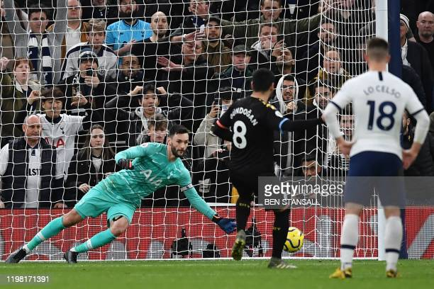 Tottenham Hotspur's French goalkeeper Hugo Lloris saves a penalty from Manchester City's German midfielder Ilkay Gundogan during the English Premier...