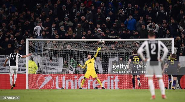 Tottenham Hotspur's French goalkeeper Hugo Lloris saves a penalty from Juventus' forward from Argentina Gonzalo Higuain during the UEFA Champions...