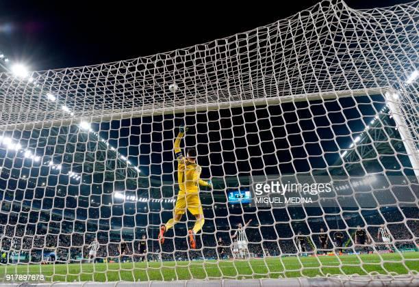 Tottenham Hotspur's French goalkeeper Hugo Lloris saves a penalty during the UEFA Champions League round of sixteen first leg football match between...