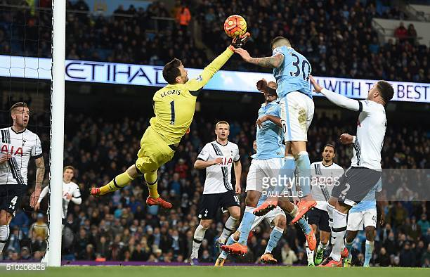 Tottenham Hotspur's French goalkeeper Hugo Lloris saves the ball from Manchester City's Argentinian defender Nicolas Otamendi during the English...