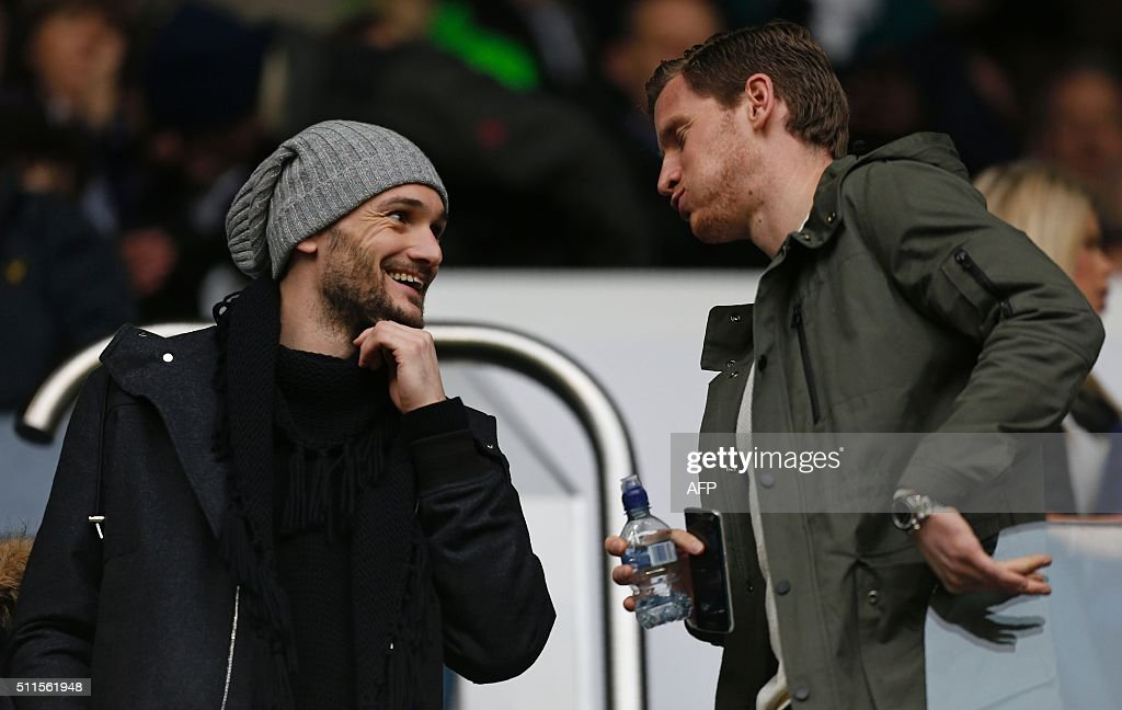 Tottenham Hotspur's French goalkeeper Hugo Lloris (L) speaks with Tottenham Hotspur's Belgian defender Jan Vertonghen (R) ahead of the FA cup fifth round football match between Tottenham Hotspur and Crystal Palace at White Hart Lane in London on February 21, 2016. Crystal Palace won the game 1-0. / AFP / IAN KINGTON / RESTRICTED TO EDITORIAL USE. No use with unauthorized audio, video, data, fixture lists, club/league logos or 'live' services. Online in-match use limited to 75 images, no video emulation. No use in betting, games or single club/league/player publications. /