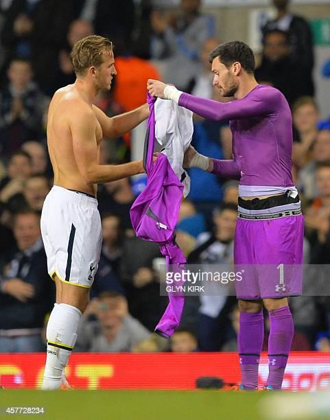 Tottenham Hotspur's French goalkeeper Hugo Lloris swaps shirts with Tottenham Hotspur's English striker Harry Kane who will cover goalkeeping duties...