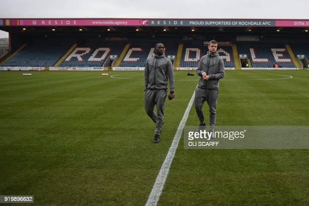 Tottenham Hotspur's French midfielder Moussa Sissoko and Tottenham Hotspur's English defender Eric Dier check out the pitch ahead of the English FA...