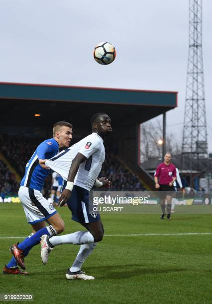 Tottenham Hotspur's French midfielder Moussa Sissoko is held back by Rochdale's English defender Mark Kitching during the English FA Cup fifth round...
