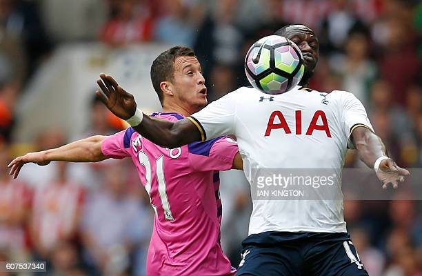 Tottenham Hotspur's French midfielder Moussa Sissoko vies with Sunderland's Spanish defender Javier Manquillo during the English Premier League...
