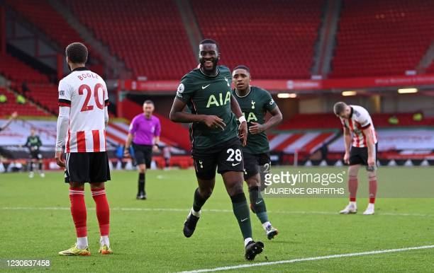 Tottenham Hotspur's French midfielder Tanguy Ndombele celebrates scoring his team's third goal with Tottenham Hotspur's Dutch midfielder Steven...