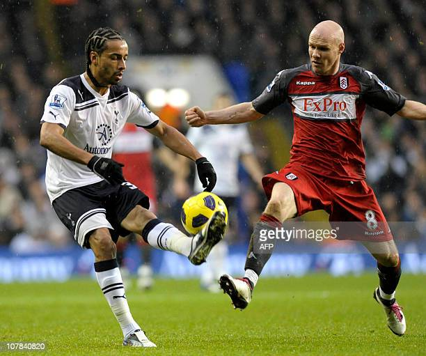 Tottenham Hotspur's FrenchCameroonian defender Benoit AssouEkotto vies with Fulham's English striker Andrew Johnson during the English Premier League...