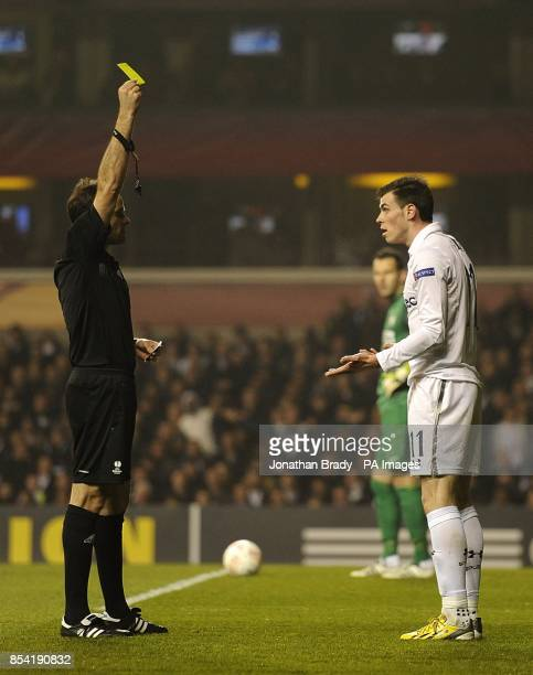 Tottenham Hotspur's Gareth Bale is booked by match referee Antonio Miguel Mateu Lahoz