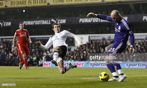 Tottenham Hotspur's Gareth Bale launches in as Liverpool goalkeeper Jose Reina prepares to clear the ball