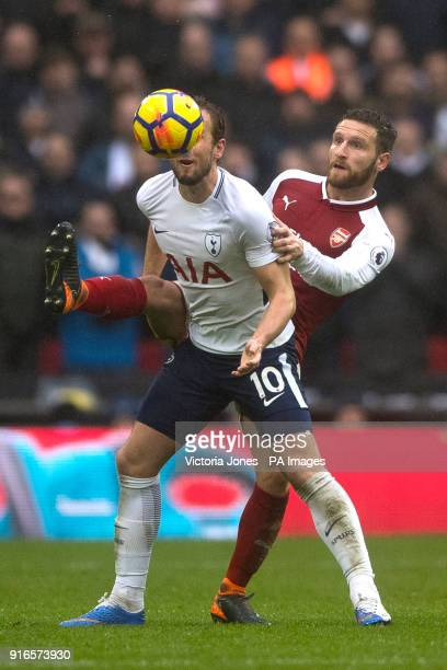 Tottenham Hotspur's Harry Kane and Arsenal's Shkodran Mustafi during the Premier League match at Wembley Stadium London