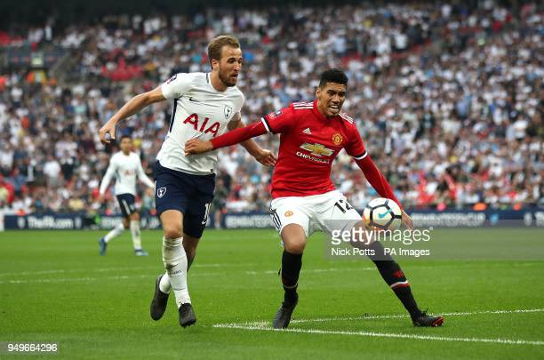 Tottenham Hotspur's Harry Kane and Manchester United's Chris Smalling battle for the ball during the Emirates FA Cup semifinal match at Wembley...