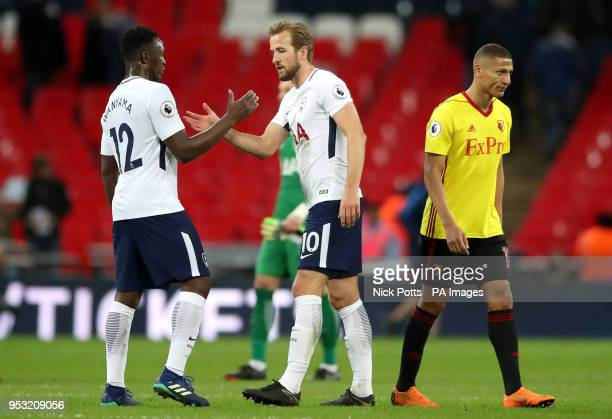 Tottenham Hotspur's Harry Kane and Victor Wanyama shake hands as Watford's Richarlison looks dejected after the Premier League match at Wembley...