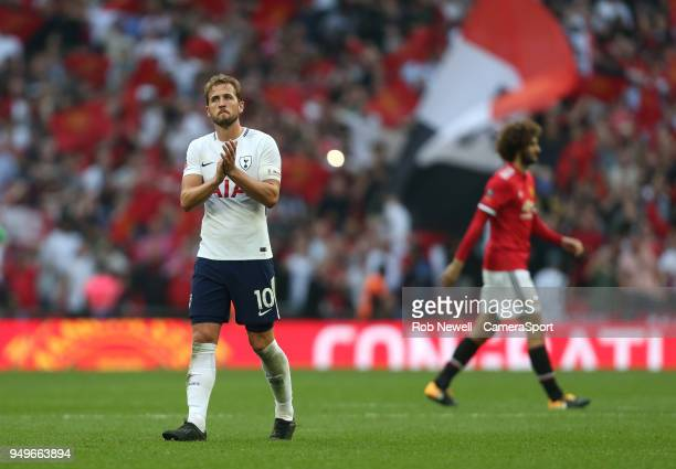 Tottenham Hotspur's Harry Kane applauds the fans at the end of the game during the Emirates FA Cup Semi Final match between Manchester United and...
