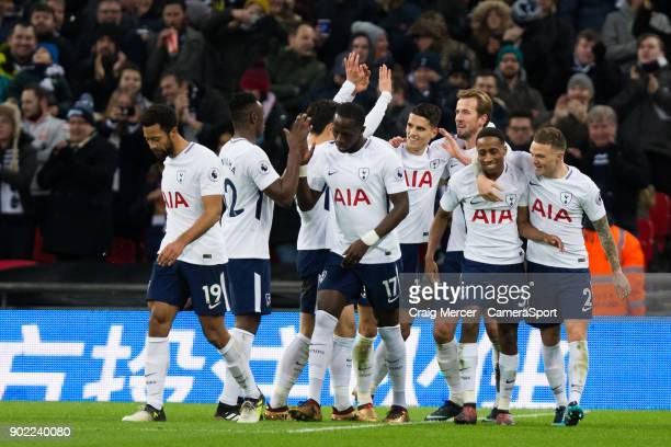 Tottenham Hotspur's Harry Kane celebrates scoring his side's second goal with team mates during the Emirates FA Cup Third Round match between...