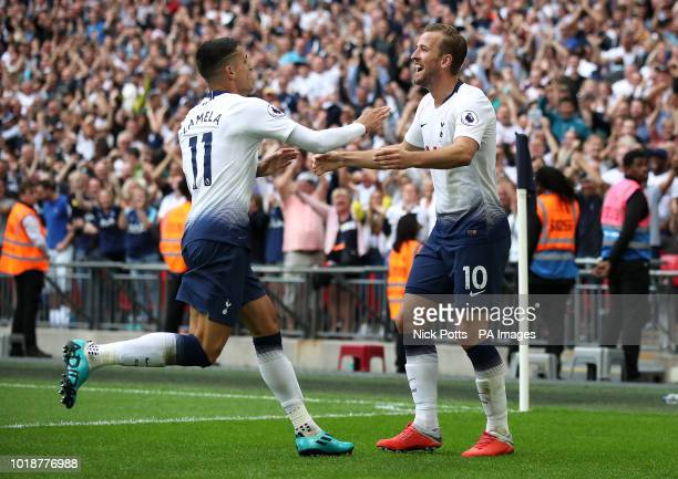 Tottenham Hotspur's Harry Kane celebrates scoring his side's third goal of the game with teammate Erik Lamela during the Premier League match at...