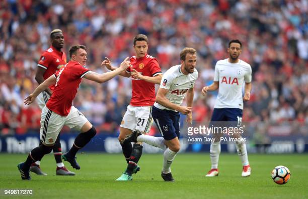 Tottenham Hotspur's Harry Kane gets away from Manchester United's Phil Jones and Ander Herrera during the Emirates FA Cup semifinal match at Wembley...