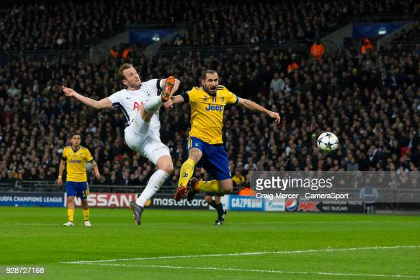 Tottenham Hotspur's Harry Kane has a shot at goal under pressure from Giorgio Chiellini of Juventus during the UEFA Champions League Round of 16...