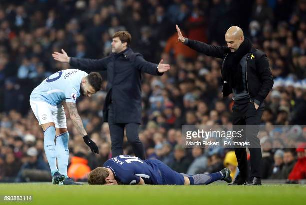 Tottenham Hotspur's Harry Kane lies on the floor after a collision with Manchester City's Nicolas Otamendi during the Premier League match at the...