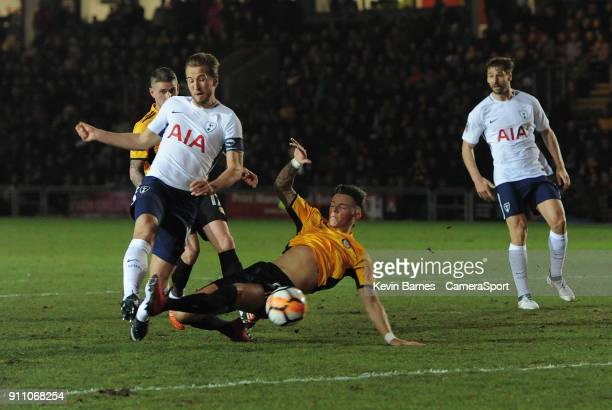 Tottenham Hotspur's Harry Kane shoots despite the attentions of Newport County's Ben White during the The Emirates FA Cup Fourth Round match between...