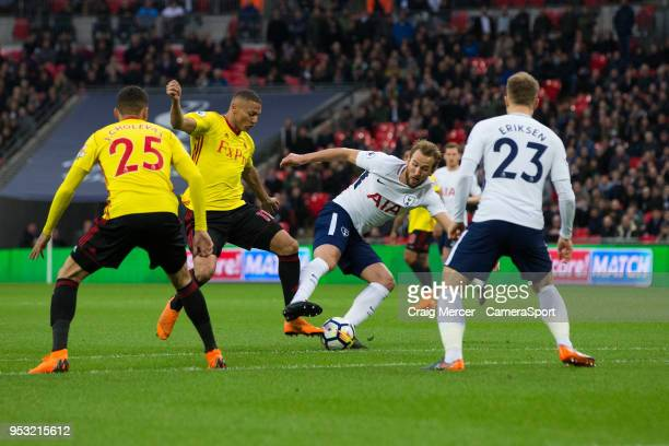 Tottenham Hotspur's Harry Kane vies for possession with Watford's Richarlison during the Premier League match between Tottenham Hotspur and Watford...