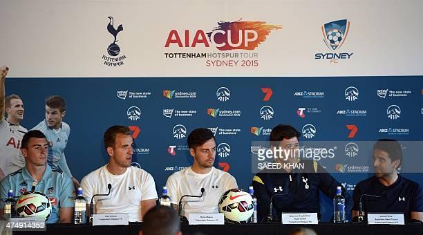 Tottenham Hotspur's head coach Mauricio Pochettino speaks at a press conference as his team's players Harry Kane Ryan Mason and Sydney FC's defender...