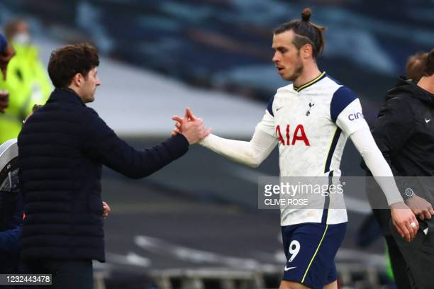 Tottenham Hotspur's head coach Ryan Mason reacts with Tottenham Hotspur's Welsh midfielder Gareth Bale on his substitution during the English Premier...