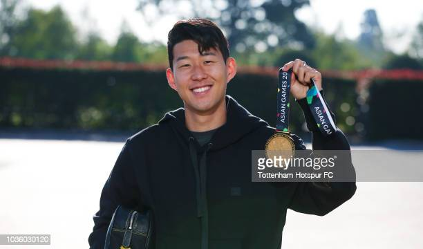 Tottenham Hotspur's HeungMin Son shows off his Asian Games gold medal on his return to Hotspur Way on September 132018 in EnfieldEngland