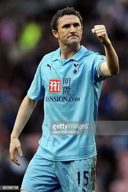 Tottenham Hotspur's Irish forward Robbie Keane celebrates at the final whistle after scoring a late goal to ensure a 11 draw during the Premier...
