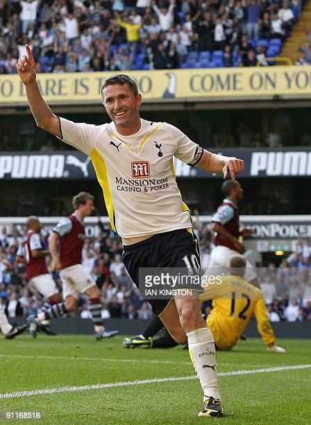 Tottenham Hotspur's Irish player Robbie Keane celebrates scoring his fourth goal during the English Premier League football match between Tottenham...