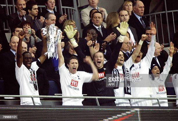 Tottenham Hotspurs' Irish striker Robbie Keane and English defender Ledley King lift the trophy after winning the Carling Cup Final match against...