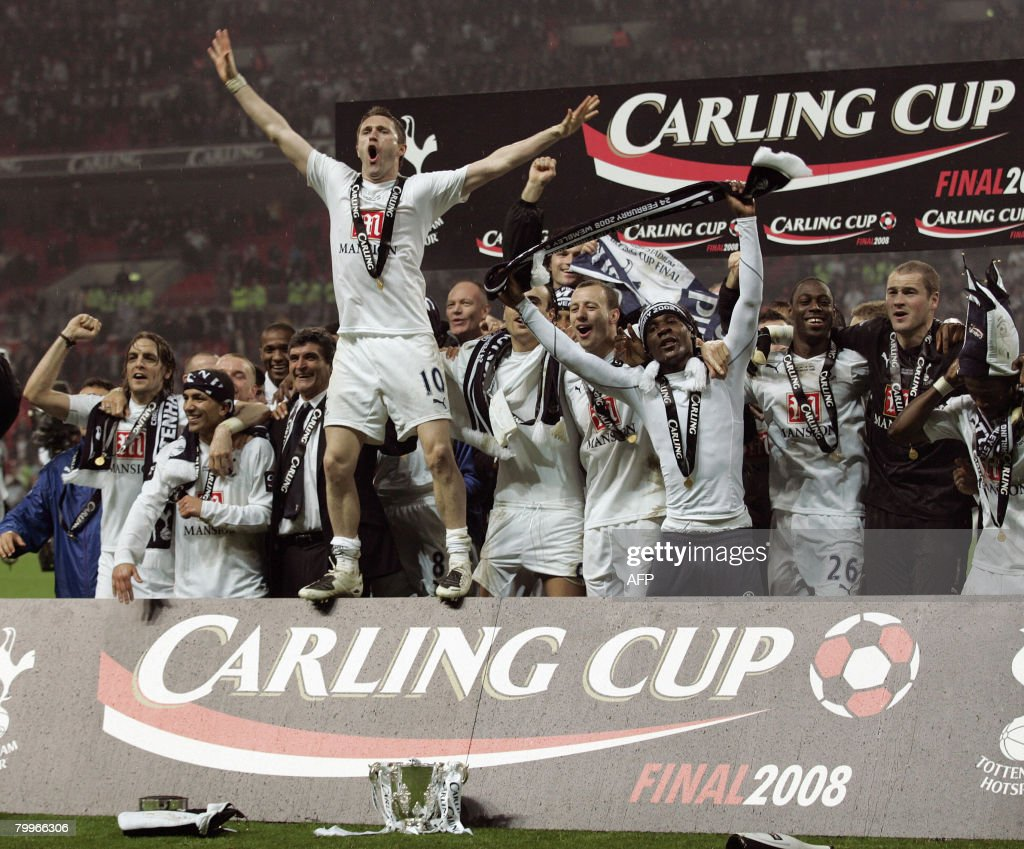 Tottenham Hotspur's Irish striker Robbie Keane (4L) celebrates with teammates after winning the Carling Cup Final against Chelsea at Wembley Stadium in London on February 24, 2008. Tottenham Hotspur won the game 2-1. AFP PHOTO GLYN KIRK Mobile and website use of domestic English football pictures are subject to obtaining a Photographic End User Licence from Football DataCo Ltd Tel : +44 (0) 207 864 9121 or e-mail accreditations@football-dataco.com - applies to Premier and Football League matches.