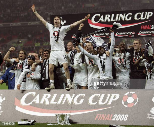 Tottenham Hotspur's Irish striker Robbie Keane celebrates with teammates after winning the Carling Cup Final against Chelsea at Wembley Stadium in...