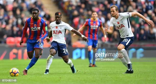 Tottenham Hotspur's Ivorian defender Serge Aurier and Tottenham Hotspur's English striker Harry Kane vie against Crystal Palace's German midfielder...