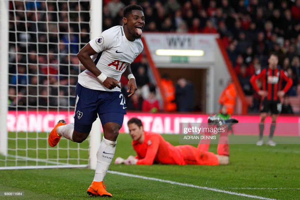 Tottenham Hotspur's Ivorian defender Serge Aurier (L) celebrates after scoring their fourth goal during the English Premier League football match between Bournemouth and Tottenham Hotspur at the Vitality Stadium in Bournemouth, southern England on March 11, 2018. / AFP PHOTO / Adrian DENNIS / RESTRICTED TO EDITORIAL USE. No use with unauthorized audio, video, data, fixture lists, club/league logos or 'live' services. Online in-match use limited to 75 images, no video emulation. No use in betting, games or single club/league/player publications. /