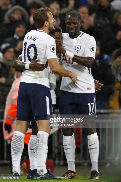Tottenham Hotspur's Ivorian defender Serge Aurier celebrates with Tottenham Hotspur's English striker Harry Kane and Tottenham Hotspur's French...