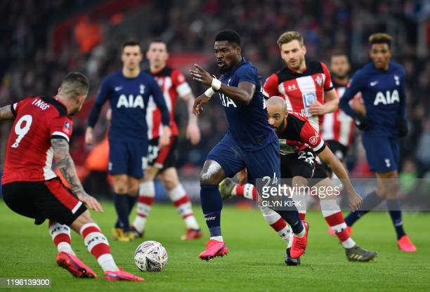 Tottenham Hotspur's Ivorian defender Serge Aurier runs with the ball during the English FA Cup fourth round football match between Southampton and...