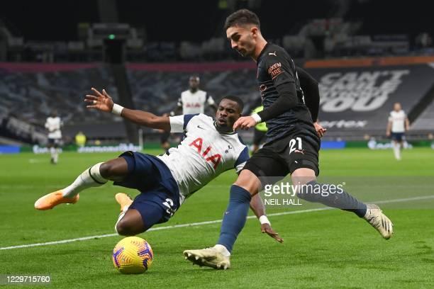 Tottenham Hotspur's Ivorian defender Serge Aurier tackles Manchester City's Spanish midfielder Ferran Torres during the English Premier League...
