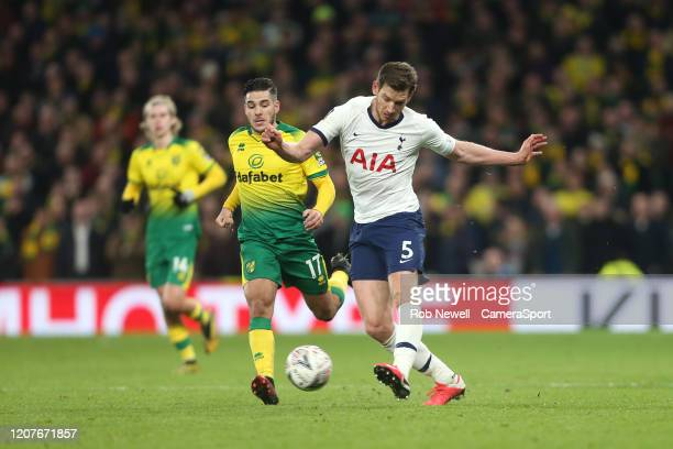 Tottenham Hotspur's Jan Vertonghen and Norwich City's Emi Buendia during the FA Cup Fifth Round match between Tottenham Hotspur and Norwich City at...
