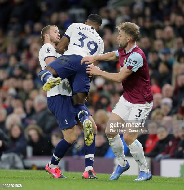 Tottenham Hotspur's Japhet Tanganga collides with Eric Dier as Burnley's Charlie Taylor looks on during the Premier League match between Burnley FC...