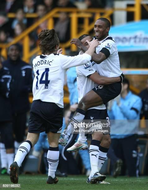 Tottenham Hotspur's Jermain Defoe celebrates scoring his side's second goal of the game with teammates Benoit AssouEkotto and Luka Modric