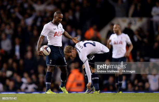 Tottenham Hotspur's Jermain Defoe has words with teammate Christian Eriksen as they prepare to restart after Hull City's Curtis Davies scores his...