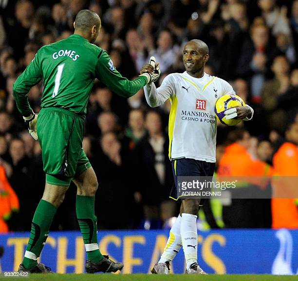 Tottenham Hotspurs' Jermain Defoe shakes hands with goalkeeper Heurelho Gomes at the end of the Premiership match against Wigan Athletic at White...