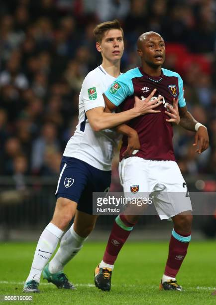 LR Tottenham Hotspur's Juan Foyth and West Ham United's Andre Ayew during Carabao Cup 4th Round match between Tottenham Hotspur and West Ham United...