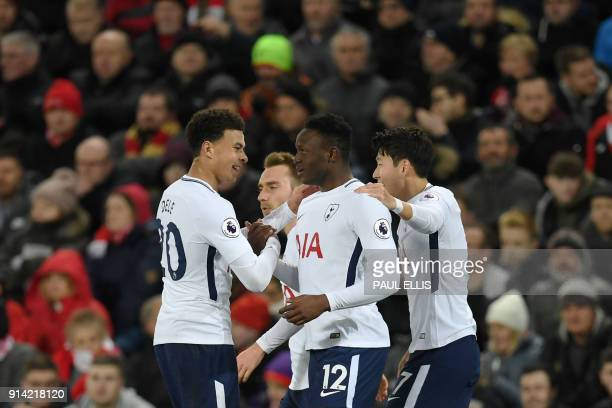 Tottenham Hotspur's Kenyan midfielder Victor Wanyama celebrates scoring his team's first goal with Tottenham Hotspur's English midfielder Dele Alli...