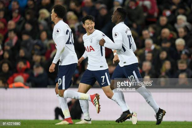 Tottenham Hotspur's Kenyan midfielder Victor Wanyama celebrates scoring his team's first goal with Tottenham Hotspur's English midfielder Dele Alli...