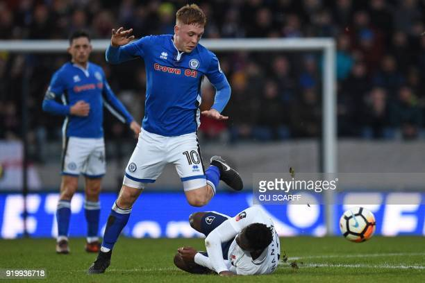 Tottenham Hotspur's Kenyan midfielder Victor Wanyama falls in a challenge with Rochdale's Northern Irish midfielder Callum Camps during the English...