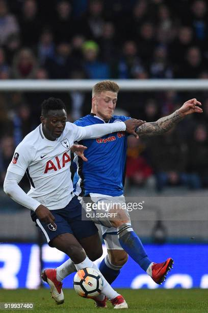 Tottenham Hotspur's Kenyan midfielder Victor Wanyama vies with Rochdale's English striker Stephen Humphrys during the English FA Cup fifth round...