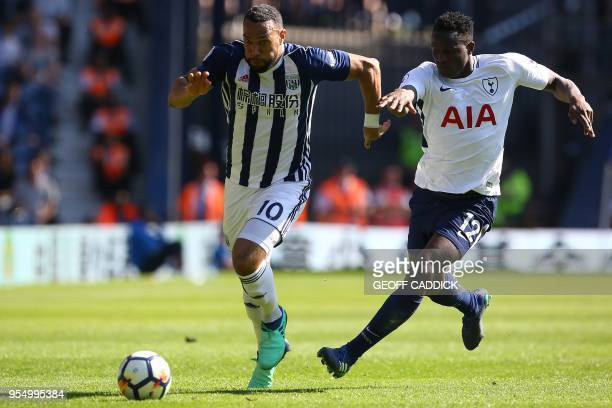 Tottenham Hotspur's Kenyan midfielder Victor Wanyama vies with West Bromwich Albion's Englishborn Scottish midfielder Matt Phillips during the...
