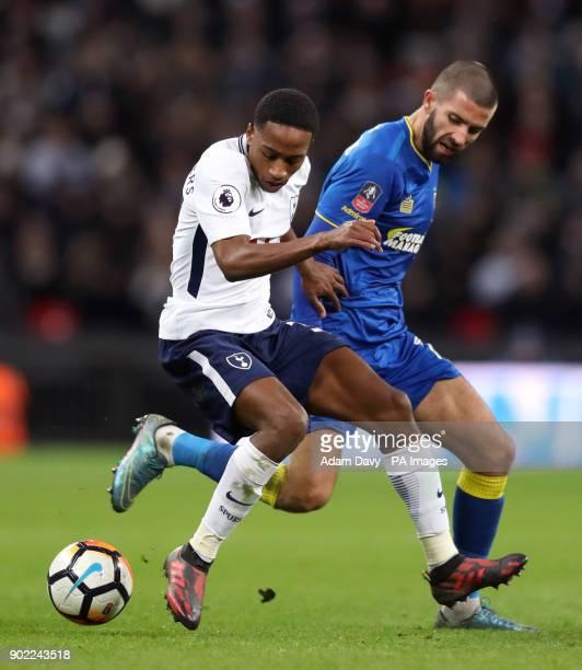 Tottenham Hotspur's Kyle WalkerPeters and AFC Wimbledon's George Francomb battle for the ball during the Emirates FA Cup Third Round match at Wembley...